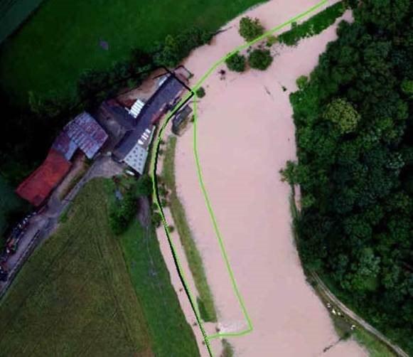 Een boerderij net over de grens met Wallonië is overstroomd, opwaarts van het gecontroleerd overstromingsgebied (GOG) in Herne.